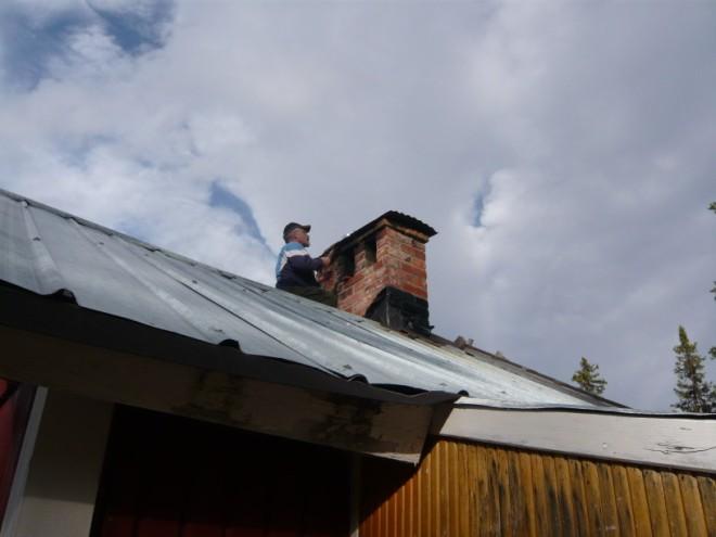 Ingvar repairing chimney