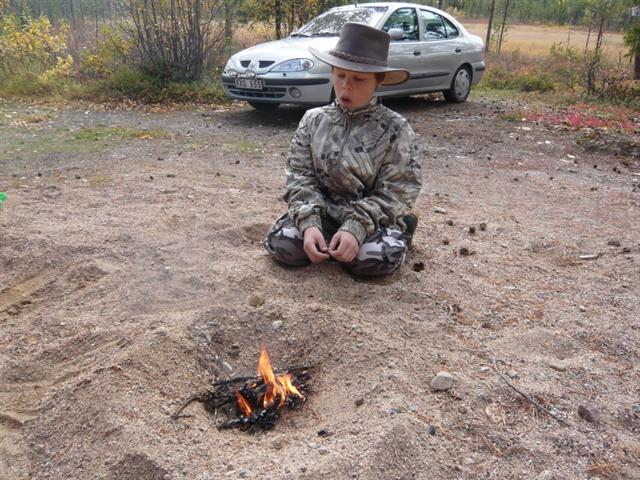 Seb with his first fire (Small)