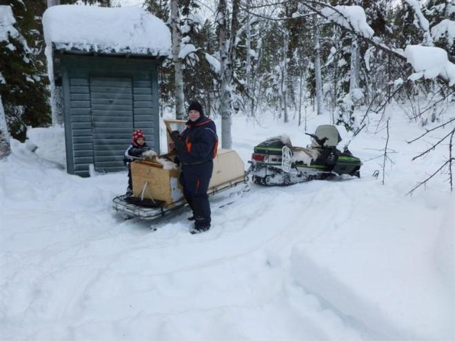 Teres and Emma with snowmobile