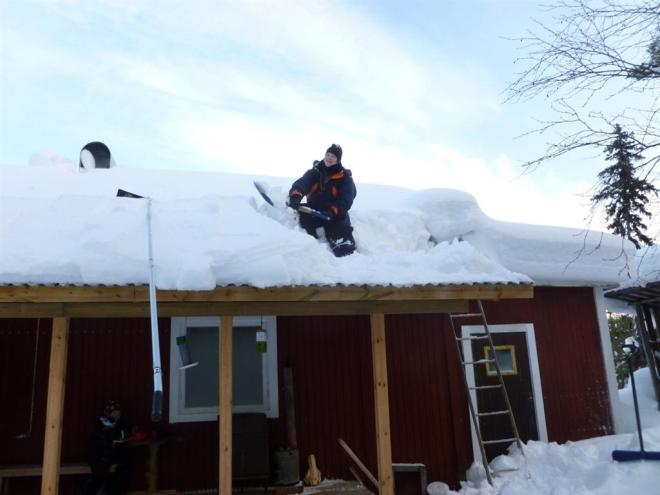 clearing snow from cabin roof