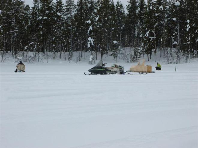 snowmobile on lake (Medium)