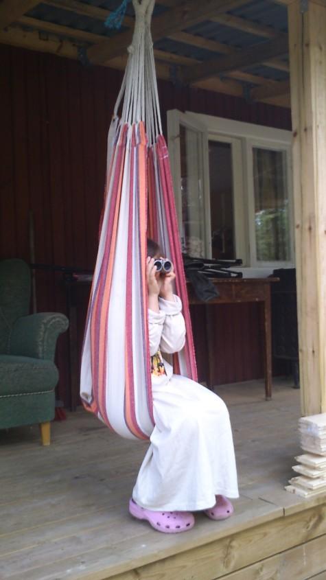 emma birdwatching from hammock